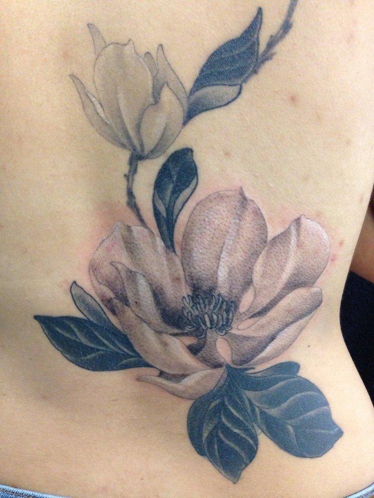 danny dunbar lily flower tattoo back
