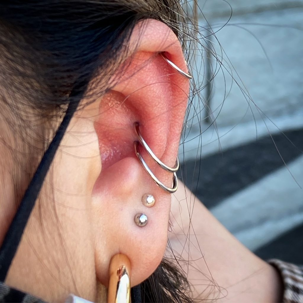 lena pop conch double helix ear piercing los angeles